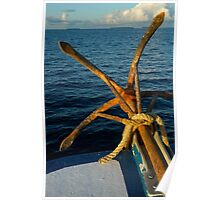 Rusty anchor on back of boat Poster