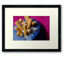 Cigarette butts in ashtray Framed Print