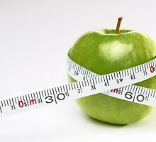 Tape measure round green apple by Sami Sarkis