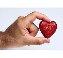 Man holding glittery heart Photographic Print