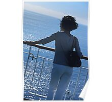 Woman looking out to sea from deck of boat Poster