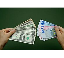 Man holding fanned out US dollars and Euro banknotes Photographic Print