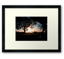 A Silhouette Sunset through the windscreen Framed Print