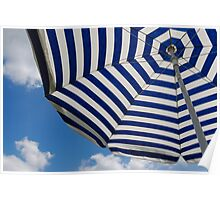 Striped beach umbrella against blue sky Poster