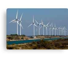 Row of wind turbines along canal, France, Camargue Canvas Print