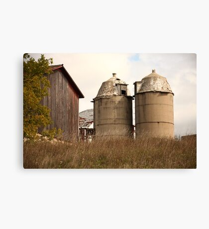 Two Old Silos Talking About the Barn Canvas Print