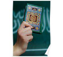 Boy's hand holding Koran Poster