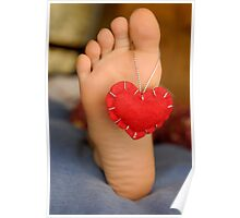 Valentine heart hanging on girl's barefeet Poster