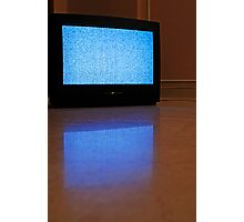 Television displaying static reflected on floor Photographic Print