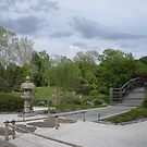 Japanese Designed Garden with Bridge and Sculpture by Paula Betz