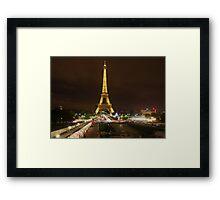 The Eiffel Tower lights up. Framed Print