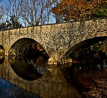 Arches over the creek by cclaude