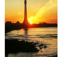 Sun bombs St. Kilda Lighthouse and misses! by Roz McQuillan