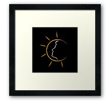 Face of a woman in the sun Framed Print