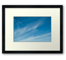 Wispy white clouds and blue sky Framed Print