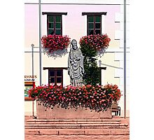 A saint and lots of flowers Photographic Print