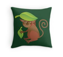 A TARSIER wild animal of the Phillipines hiding under leaves Throw Pillow
