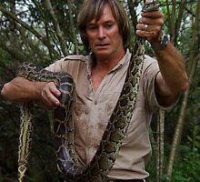 Austin Stevens with Burmese python by Austin Stevens