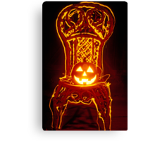 Carved smiling pumpkin on chair Canvas Print