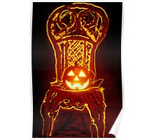 Carved smiling pumpkin on chair Poster