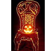 Carved smiling pumpkin on chair Photographic Print
