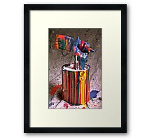Hand coming out of paint can Framed Print