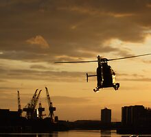 Sunset and helicopter on the River Clyde by ElsT
