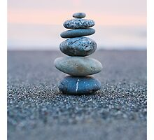 Rock stack on the beach at sunset by Tim McGuire