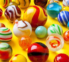 Lots of colorful marbles by Garry Gay