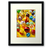 Lots of colorful marbles Framed Print