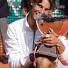 Rafa Nadal biting his 7th consecutive Monte-Carlo trophy by nadalnews