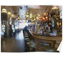 Haunted? What sits on the 2nd bar stool in front? Poster