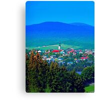 Village below the mountains Canvas Print