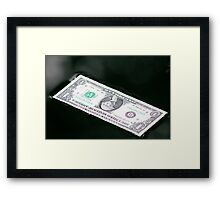 Floating Bill on on water Framed Print