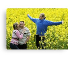 Three people in meadow Canvas Print