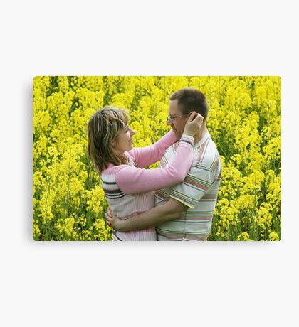 Couple in flower meadow Canvas Print