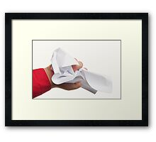 Crumpled paper in hand Framed Print