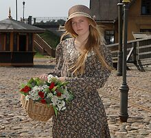 Girl with basket of flowers by fotorobs