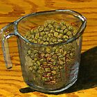 Two cups of golden raisins on deck by bernzweig