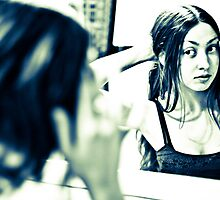 Looking in the mirror by Ayla Maya