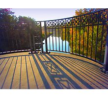 Wrought iron fence on bridge overlooking fall trees Photographic Print
