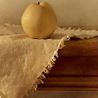 apple pear on a table by Priska Wettstein