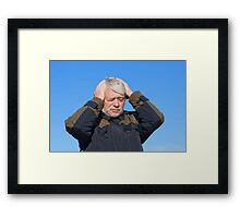 Portrait of middle-aged man on blue sky of the background. Framed Print