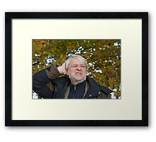 Portrait of middle-aged man in autumn day. Framed Print