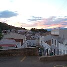 Sunset, the streets of Oliva. by John  Smith