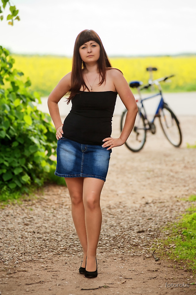 Sexy woman with bicycle by fotorobs