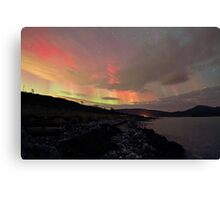 Red Auroras over the beach Canvas Print