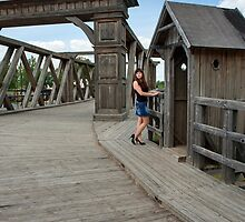 Beauty girl on old-time bridge. by fotorobs