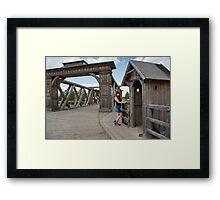 Beauty girl on old-time bridge. Framed Print