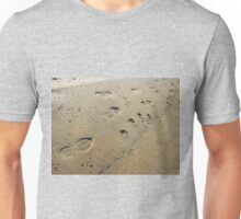 Overhead view on the wet sand at the beach with footprints Unisex T-Shirt